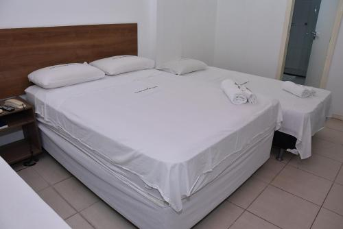 A bed or beds in a room at Equatorial Hotel