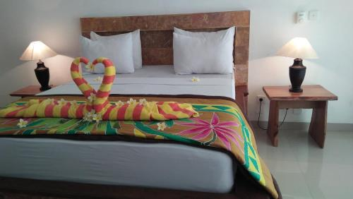 A bed or beds in a room at Ocean Resort Amed