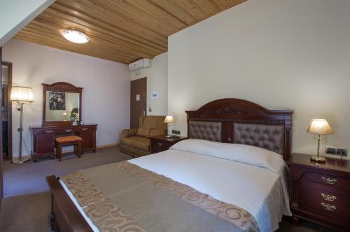 Ένα ή περισσότερα κρεβάτια σε δωμάτιο στο Δίας