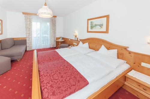 Ein Bett oder Betten in einem Zimmer der Unterkunft Pension Oberjörg