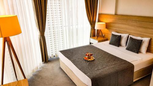 Кровать или кровати в номере Ozyigit Otel
