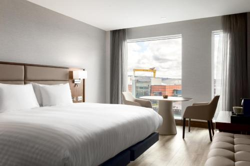 A bed or beds in a room at AC Hotel by Marriott Belfast
