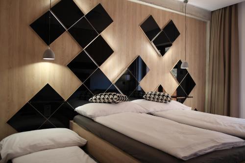 Posteľ alebo postele v izbe v ubytovaní Apartmány 16+17 Romantika Chopok Juh Tále