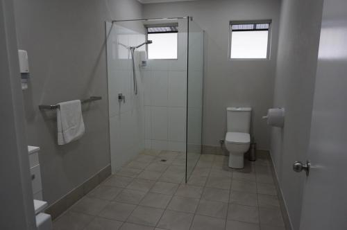 A bathroom at YAL Cairns - Accommodation that makes a difference