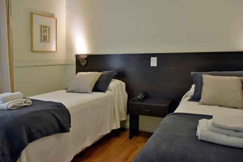 A bed or beds in a room at Abril Hotel Boutique