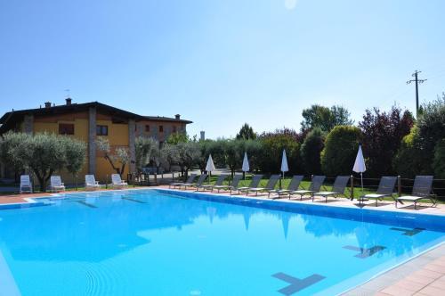 The swimming pool at or close to Azienda Agrituristica Armea