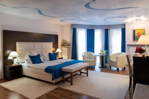 Ein Bett oder Betten in einem Zimmer der Unterkunft DAS CENTRAL - City Boutique Hotel