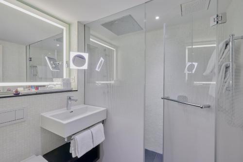 Ein Badezimmer in der Unterkunft Sorell Hotel Krone