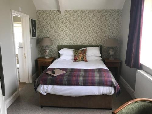 A bed or beds in a room at The George Inn - Lacock