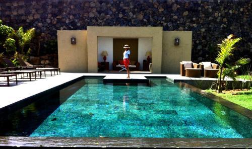 The swimming pool at or near Hacienda Cuatro Ventanas