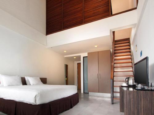 Кровать или кровати в номере Mikie Holiday