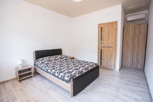 Кровать или кровати в номере Абхазия Тали