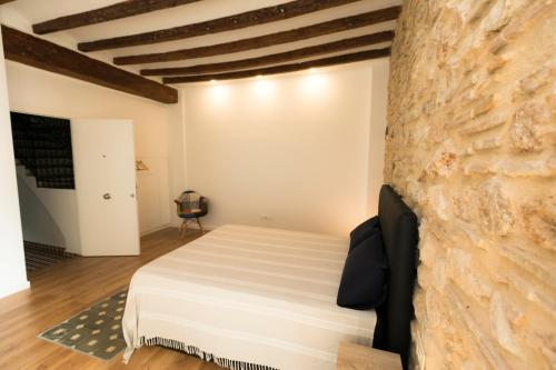 A bed or beds in a room at Casa Olivera