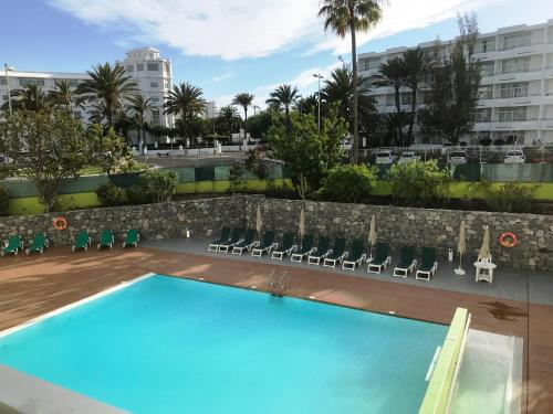A view of the pool at Apartamentos Los Aguacates or nearby