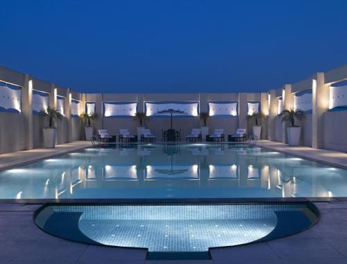 The swimming pool at or close to Hilton Garden Inn New Delhi/Saket