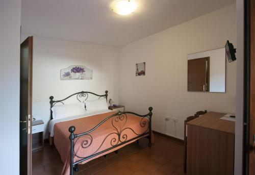 Letto o letti in una camera di Hotel Athena