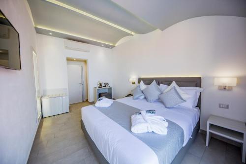 Letto o letti in una camera di Ossuna Bay Hotel Boutique