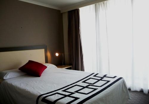 A bed or beds in a room at One Darling 109