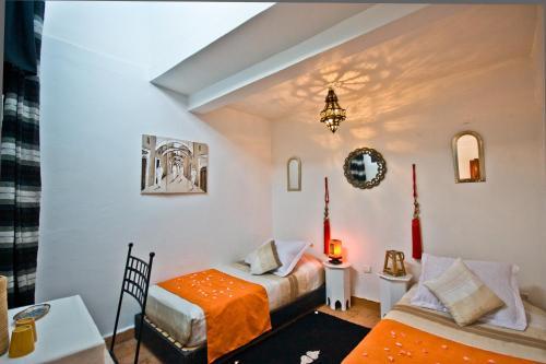 Un ou plusieurs lits dans un hébergement de l'établissement Dar Nafoura-Mogador