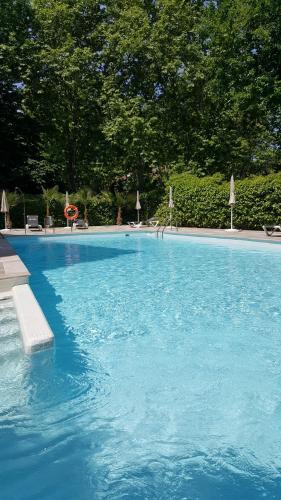The swimming pool at or near Senator Barajas