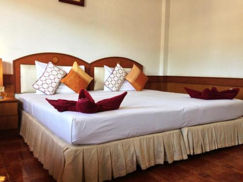 A bed or beds in a room at The New Villa