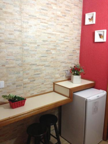 A kitchen or kitchenette at Hotel Vagalume