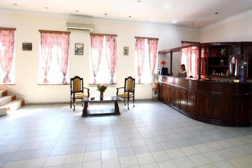 The lobby or reception area at Rose Hotel