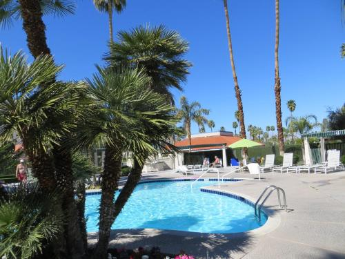 The swimming pool at or near Travelodge by Wyndham Palm Springs