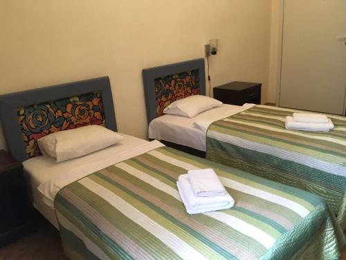 A bed or beds in a room at Hostel Viktorija with Private Rooms