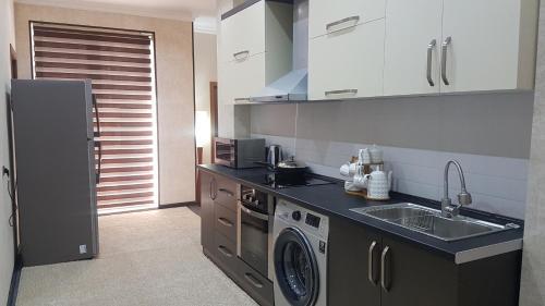 Кухня или мини-кухня в Rohat apartaments