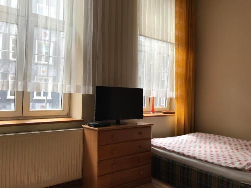 Telewizja i/lub zestaw kina domowego w obiekcie Apartament Ogarna