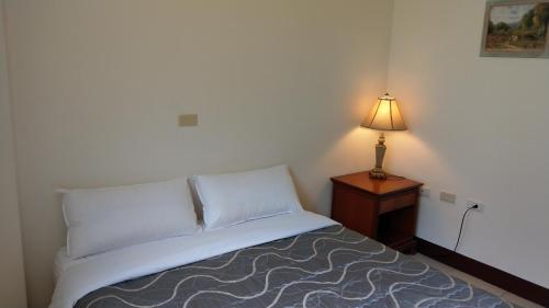 A bed or beds in a room at 168 Living Water