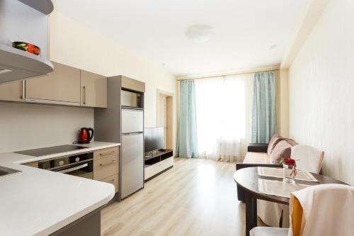 Кухня или мини-кухня в Apartment Comfort 32