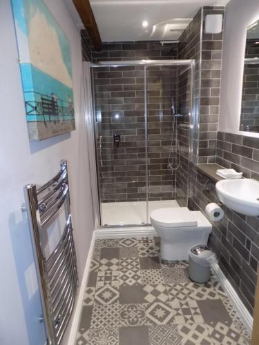 A bathroom at The Old Wool House Apartments