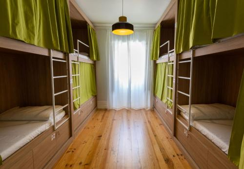 A bunk bed or bunk beds in a room at Allgo Hostel