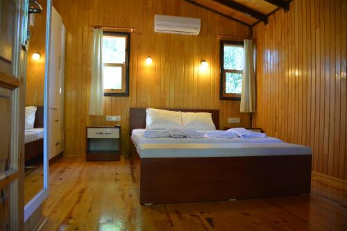 A bed or beds in a room at Caretta Caretta Pension