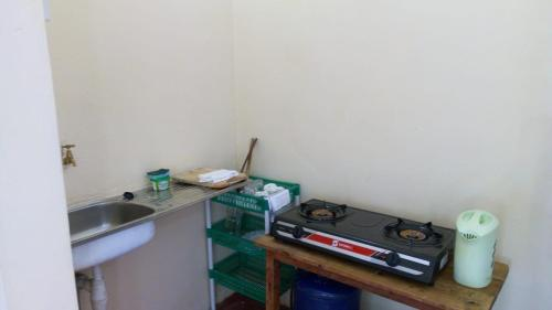 A kitchen or kitchenette at Happy Valley self Catering Thika.