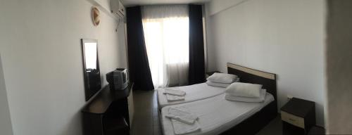 A bed or beds in a room at Tiberius Residence