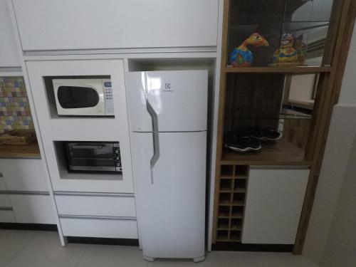 A cozinha ou cozinha compacta de Apartamentos Férias Florianópolis