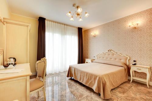 Cama ou camas em um quarto em Hotel New Reiter
