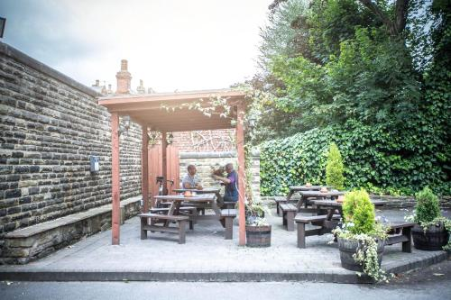 A restaurant or other place to eat at The Manor House Hotel