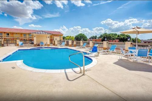The swimming pool at or near Days Inn by Wyndham North Dallas/Farmers Branch