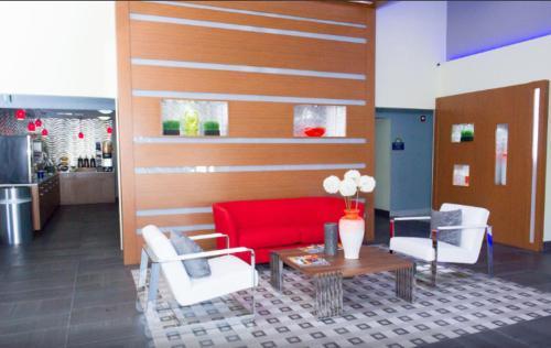 The lobby or reception area at Days Inn by Wyndham North Dallas/Farmers Branch