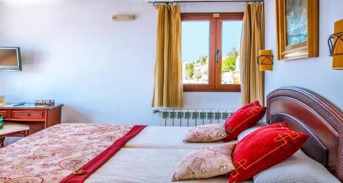 Un ou plusieurs lits dans un hébergement de l'établissement Hotel Mirador Arabeluj