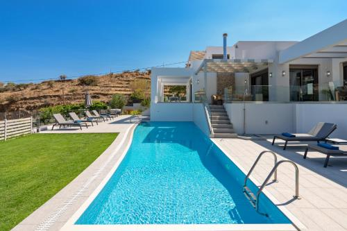 The swimming pool at or close to Eolia Villa, beach relaxation!