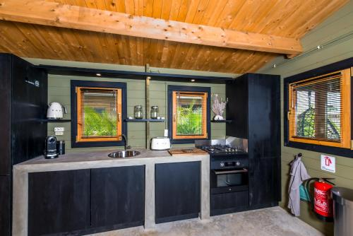 A kitchen or kitchenette at Bonaire Boutique Resort