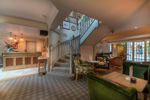 The lobby or reception area at The Three Swans Hotel, Hungerford, Berkshire