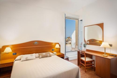Postel nebo postele na pokoji v ubytování Hotel Delfino