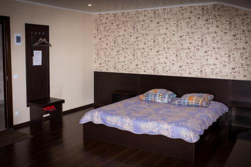 Кровать или кровати в номере Гостиница Акият