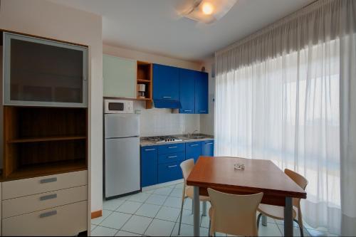 Kuchyň nebo kuchyňský kout v ubytování Residence Torre di Noe